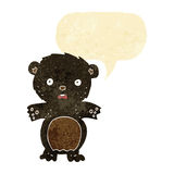 Frightened black bear cartoon with speech bubble Royalty Free Stock Images