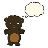 Frightened black bear cartoon with thought bubble Royalty Free Stock Images