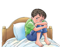 Frightened boy. A boy in stressful gesture try to hide himself at his bedroom Royalty Free Stock Photos