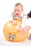 Frightened boy on the ball Royalty Free Stock Photo