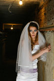 Frightened bride in dungeon Stock Photo