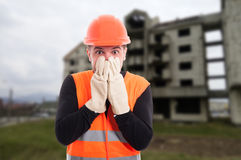 Frightened builder looking shocked Stock Photography
