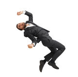 Frightened businessman falling down. And screaming. isolated on white background Stock Photos