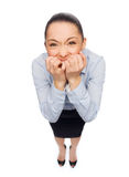 Frightened businesswoman biting her fingers Royalty Free Stock Image