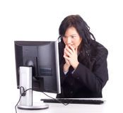 Frightened businesswoman with computer Royalty Free Stock Images