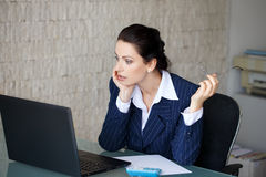 Frightened businesswoman got virus on laptop Royalty Free Stock Photography