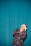 Frightened christmas man wearing a santa hat Royalty Free Stock Image