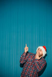 Frightened christmas man wearing a santa hat Stock Images