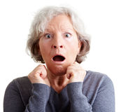 Frightened elderly woman shocked. Frightened elderly woman looking surprised and shocked stock photo