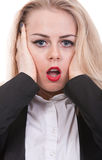 Frightened face of a young woman, grimace. Frightened blond put her head in her hands Royalty Free Stock Photos