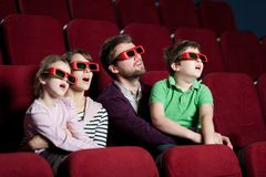 Frightened family in 3D movie Stock Images