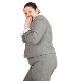 Frightened fat businesswoman. Frightened overweight, fat businesswoman in grey suit, series Royalty Free Stock Photo