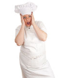 Frightened fat female cook stock photography