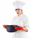 Frightened fat female cook keeping blue pot Royalty Free Stock Image