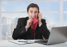 Frightened frustrated businessman talking phone Royalty Free Stock Image