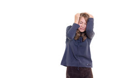 Frightened girl in blouse and skirt Stock Images
