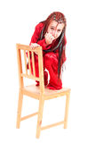 Frightened girl on the chair Royalty Free Stock Photo
