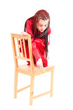Frightened girl on the chair Stock Photo