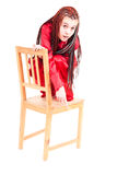 Frightened girl on the chair Stock Photography