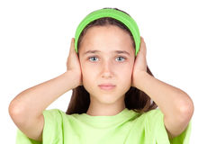 Frightened girl with ears plugged. Isolated on a white background royalty free stock photography