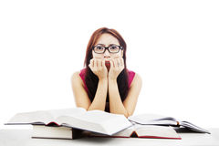 Frightened girl with textbooks Stock Photos