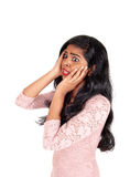 Frightened Indian woman. A lovely young Indian woman holding both hands on her face and looking Stock Photography
