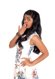 Frightened Indian woman. A lovely young Indian woman holding her hand over her mouth and Stock Photo