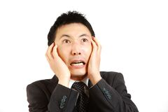 Frightened Japanese businessman Stock Photos