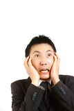 Frightened Japanese businessman Stock Photography