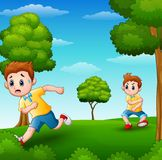 A frightened kid running because disturbed naughty child in the garden Stock Photo