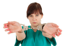 Frightened  lady doctor with handcuffed hands Stock Images