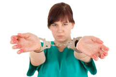 Frightened  lady doctor with handcuffed hands Royalty Free Stock Photo