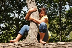 Frightened lady in a tree Royalty Free Stock Photo