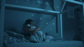 Frightened little girl cant fall asleep at night. My fear. Frightened little girl sitting in her bed and having a phobia while cant fall asleep at night stock footage