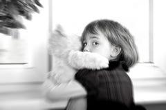 Frightened little girl. Hugging teddy bear stock images