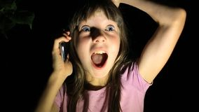 Frightened little girl, screaming and calling for help, trying to get through the phone to parents. the child was lost