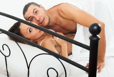 Frightened lovers caught during adultery Royalty Free Stock Photo