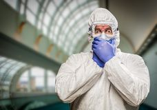 Frightened Man Covering Mouth With Hands Wearing HAZMAT Protective Suit Royalty Free Stock Images
