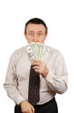 Frightened man hid his face behind the money Stock Photo
