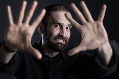 Frightened man showing STOP with both hands. stock image
