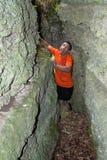 A frightened man, stuck between rocks and he`s having fun. On a warm summer evening Stock Photos