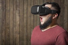 Frightened man with vr. Virtual reality glasses Stock Photo