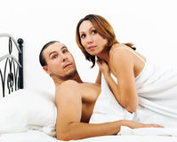 Frightened man and woman caught during adultery Royalty Free Stock Image