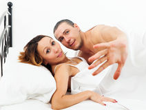 Frightened  man and woman caught during sex Royalty Free Stock Image