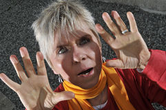 Frightened middle aged woman Royalty Free Stock Image