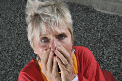 Frightened middle aged woman Royalty Free Stock Photo