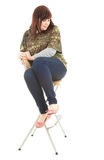 Frightened overweight woman on the chair Royalty Free Stock Photos