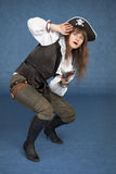 Frightened pirate girl - with pistol on a blue Royalty Free Stock Images