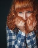 Frightened red-haired woman Royalty Free Stock Photo