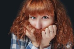 Frightened red-haired woman Stock Photos